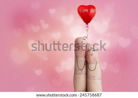 Happy Valentine's Day theme series. Painted fingers smile and love. Finger art of a Happy couple. Lovers is embracing and holding red heart. Stock Image - stock photo