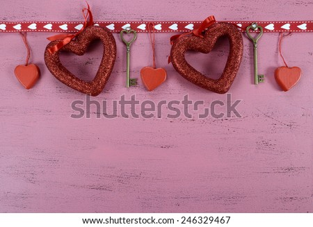 Happy Valentines Day background with hanging heart and key decorations with copy space. - stock photo