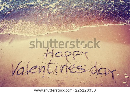 Happy Valentines day written on sand  - stock photo