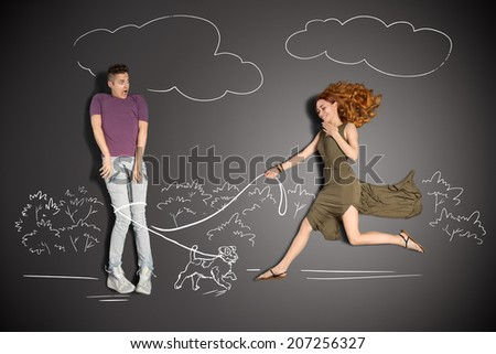Happy valentines love story concept of a romantic couple against chalk drawings background. Male entrapped into to the leash by a cute puppy.  - stock photo