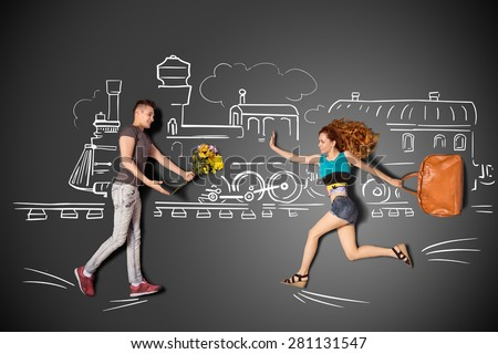 Happy valentines love story concept of a romantic couple meeting at the railway station against chalk drawings background. - stock photo