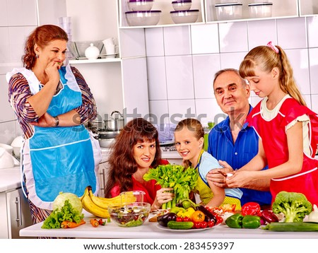 Happy very big family with kids cooking at kitchen. Grandfather and grandmother. - stock photo