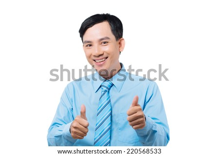 Happy Vietnamese manager showing thumbs-up - stock photo