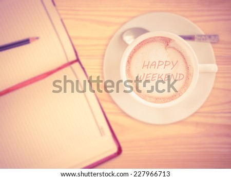 Happy weekend on Coffee Cup with vintage filter - stock photo