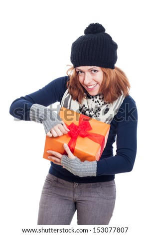 Happy winter woman opening present, isolated on white background. - stock photo