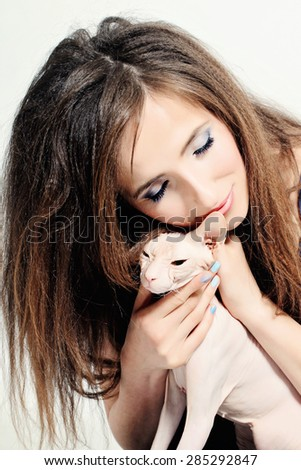 Happy Woman and Cat Hairless Sphynx - stock photo