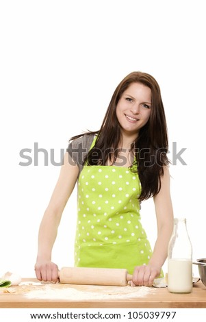 happy woman baking using rolling pin on dough on white background - stock photo