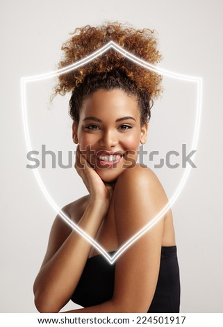 happy woman behind the shield, protecting skin - stock photo