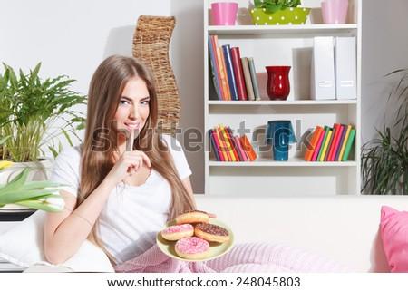 Happy woman breaks diet - stock photo