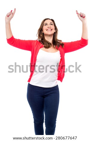 Happy woman celebrating with her arms raised - stock photo