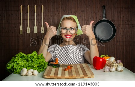 Happy woman cook with okay sign, vegetable on desk - stock photo