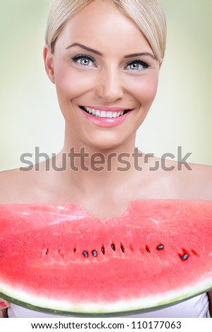 happy woman eating fresh slice of watermelon - stock photo