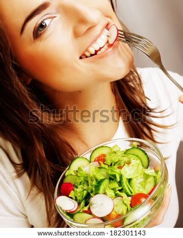 happy woman eating salad - stock photo
