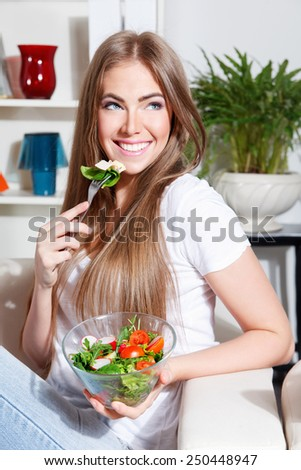 Happy woman eating salad - stock photo