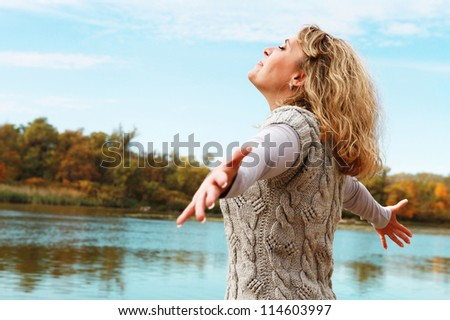 Happy woman enjoying leisure at the river - stock photo