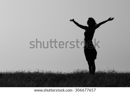 Happy woman enjoys outdoor.Happy woman Image is intentionally with grain and toned. - stock photo