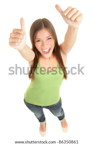 Happy woman giving thumbs up success hand sign standing excited and cheerful isolated in full length on white background. Young fresh and beautiful mixed race Caucasian Asian female model in her 20s. - stock photo