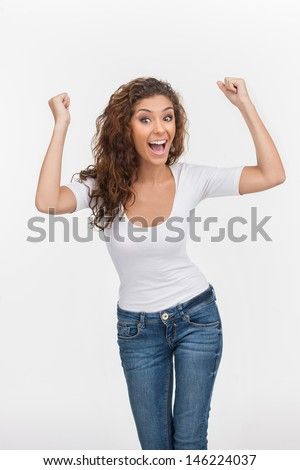 Happy woman. Happy young women gesturing while isolated on white - stock photo