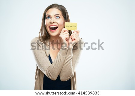 Happy woman hold credit card. White background isolated. - stock photo