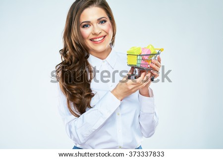 Happy woman hold market cart with presents. White background isolated. Long curly hair. - stock photo
