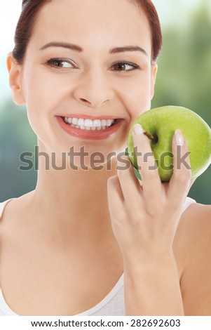 Happy woman holding an apple. - stock photo