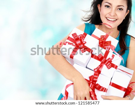 happy woman holding present in her hand - stock photo