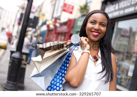 happy woman holding shopping bags - stock photo