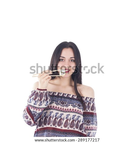 Happy woman holding sushi against a white background - stock photo