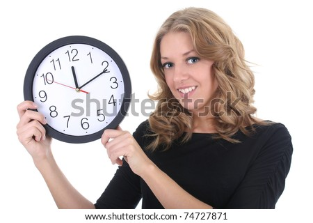 Happy woman in black with clock over white - stock photo