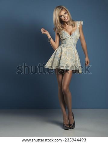 Happy woman in blue dress - stock photo