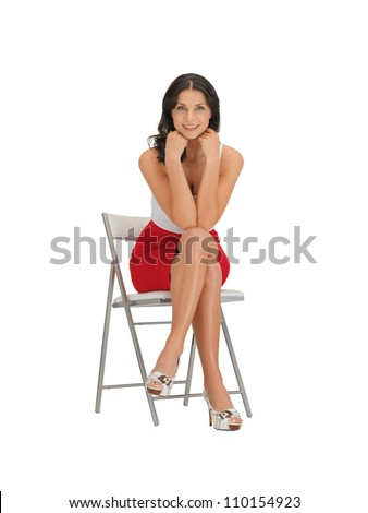 happy woman in dress on a chair - stock photo