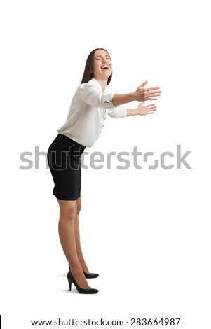 happy woman in formal wear with closed eyes laughing and stretching her hands like ready for hug. isolated on white background - stock photo