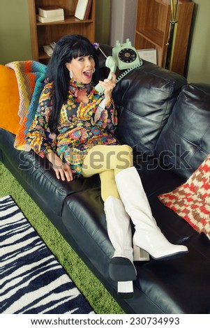Happy woman in go go boots teasing someone on phone - stock photo