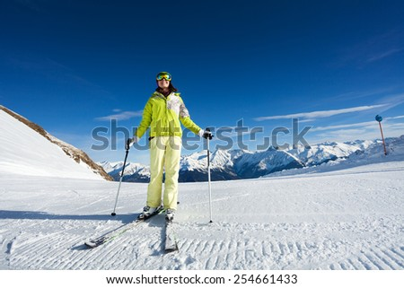 Happy woman in mask skiing on ski-track slone - stock photo