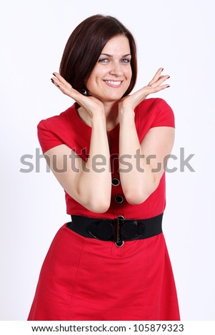 Happy woman in red dress. - stock photo