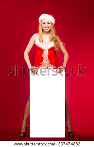 happy woman in santa helper hat - stock photo