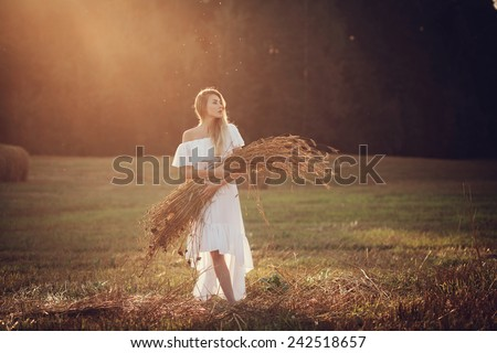 Happy woman in the field - stock photo