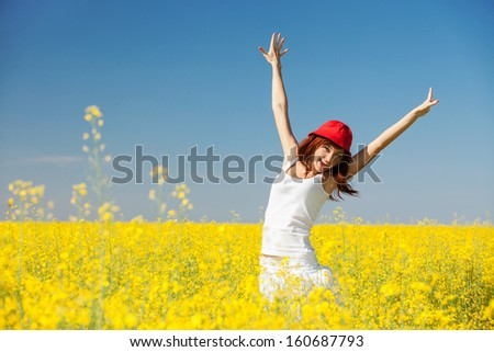 Happy woman in the field with flowers - stock photo