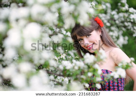 happy woman in the spring, in the lush garden. - stock photo
