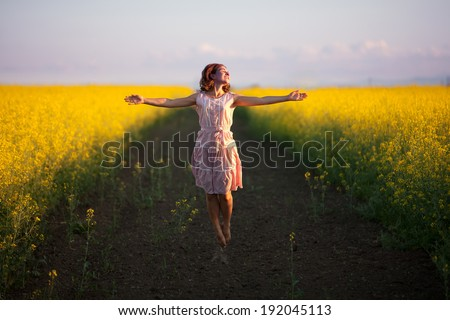 happy woman  in the yellow meadow - stock photo