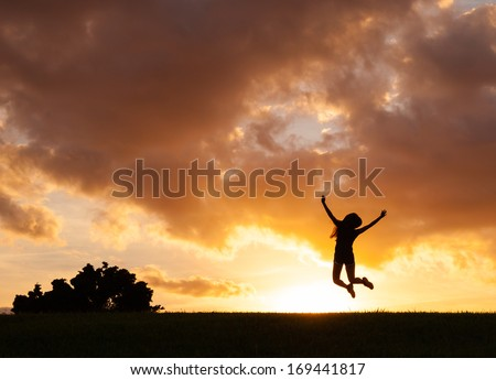 Happy woman jumping against sunset. Freedom concept. Enjoyment. - stock photo