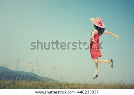 Happy Woman Jumping with blue sky.Summer Vacation .Vintage tone. - stock photo