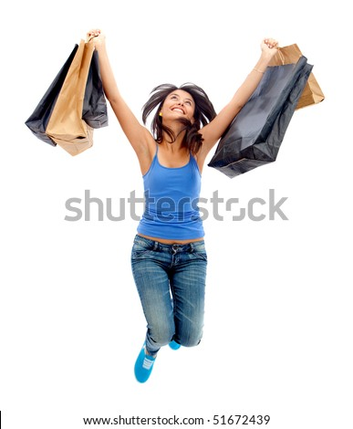 happy woman jumping with shopping bags isolated over a white background - stock photo