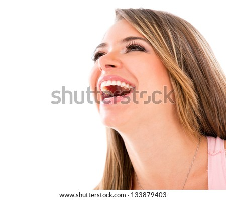 Happy woman laughing - isolated over a white background - stock photo