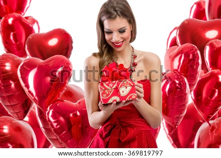Happy woman looking at her gift for Valentine's day - stock photo