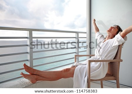 Happy woman looking on the ocean. Resort. - stock photo