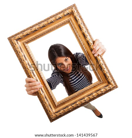 happy woman looking through frame on white background - stock photo