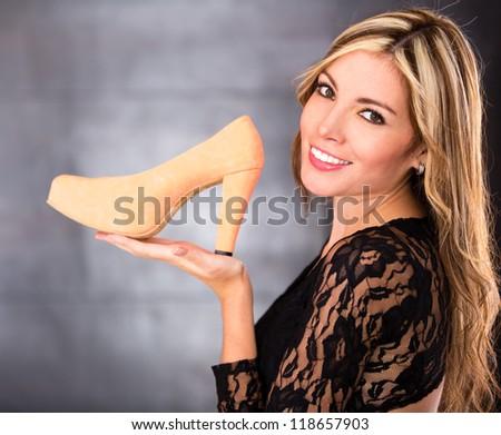 Happy woman loving her beautiful high heels - stock photo