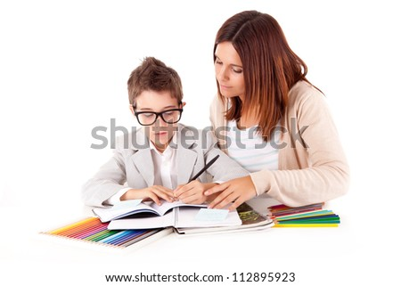 Happy woman, mother or teacher helping kid with schoolwork - stock photo