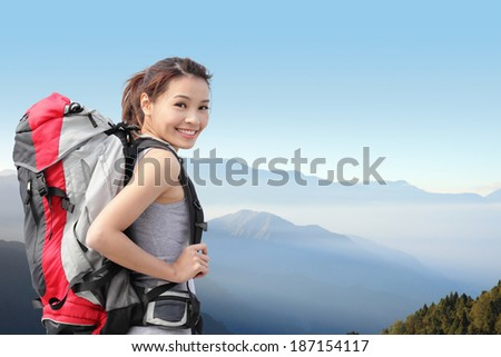 happy woman mountain hiker with backpack and smile to you on the top of mountains. asian - stock photo
